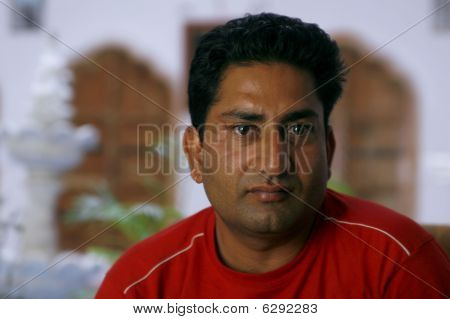 Handsome But Serious Indian Man Looking Straight Into The Camera