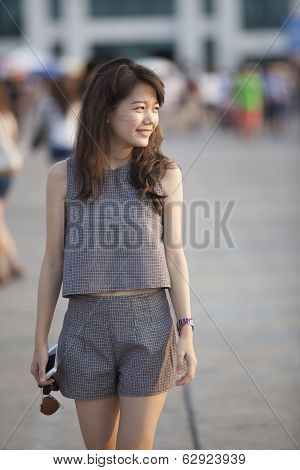 Young Attractive Asian Woman Walking Out Door With Relaxing And Easy Feeling