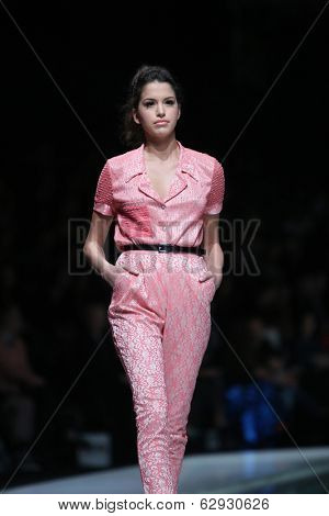 ZAGREB, CROATIA - MARCH 29: Fashion model wearing clothes designed by Envy Room on the 'Fashion.hr' show on March 29, 2014 in Zagreb, Croatia.