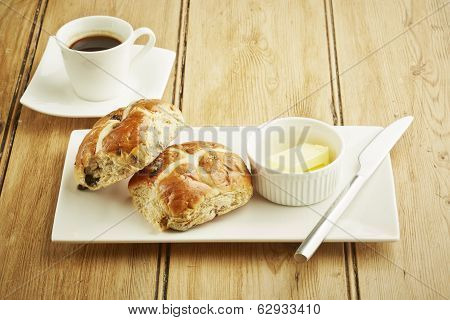 Hot Cross Bun On White Dish