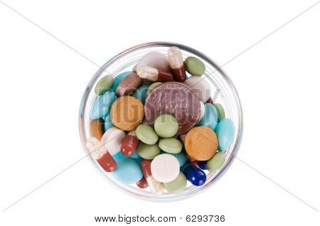 Fifty Cents In Saucer Full Of Pills