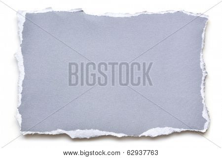 Torn blue paper, isolated on white with shadow.