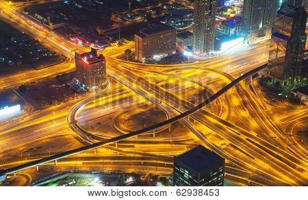 Long exposure of motorway at night city. Crossing of two motorways