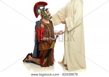Jesus with his hand on a Roman soldier isolated on a white background