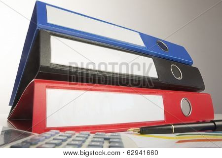 Stack of three business binders low angle view