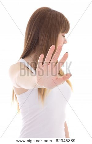 Teenage Girl Making A Stop Sign With Hand Isolated On White
