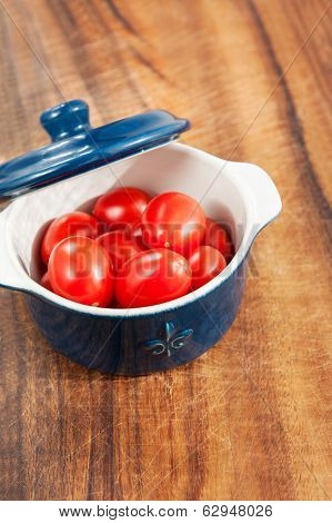 Small Cherry Tomatoes In Mini Cocotte. Closeup.