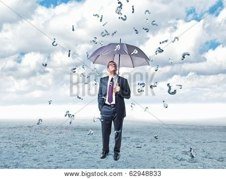 businessman with umbrella and question mark rain