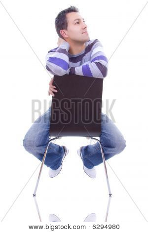 The Thoughtful Young Man On A Chair, Isolated On White Background