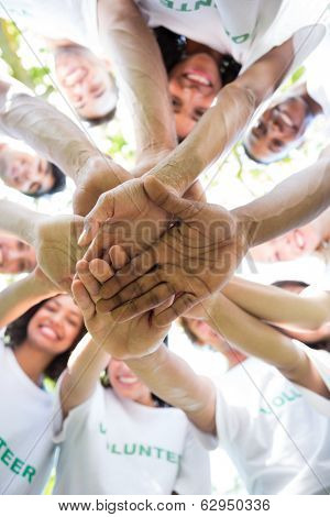 Low angle view of multiethnic environmentalists stacking hands
