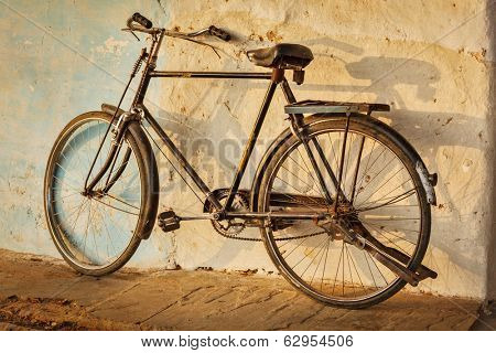 Old Indian bicycle in the street of India