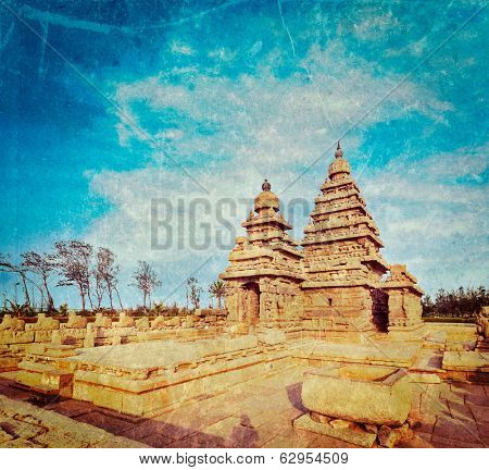 Vintage retro hipster style travel image of famous Tamil Nadu landmark - Shore temple, world  heritage site in  Mahabalipuram, Tamil Nadu, India with grunge texture overlaid