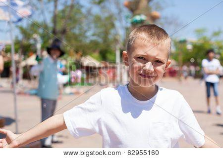 Cute boy at an amusement park.
