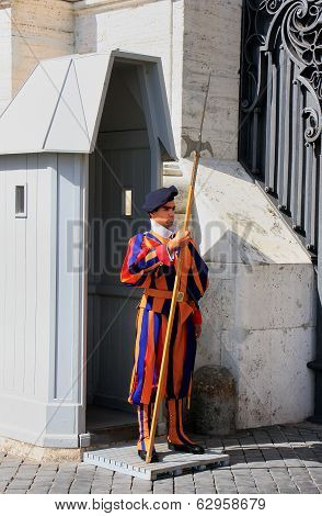VATICAN - AUGUST 4: An unidentified man guards the gate on August 4, 2011 in Vatican. Vatican City i