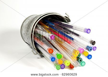 Overturned Bucket Containing Collection Of Bright Colored Pens