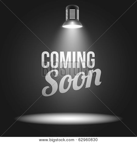Coming soon message illuminated with light projector