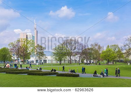 HANOVER, GERMANY - APRIL 7:  Visitors of Hannover Messe in the park. April 7, 2014. The Hannover Messe is the largest industrial trade fair in the world