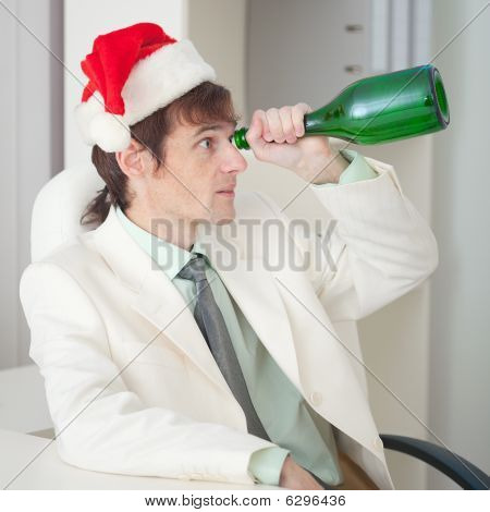 Drunk Man In Christmas Cap Plays The Fool With Bottle
