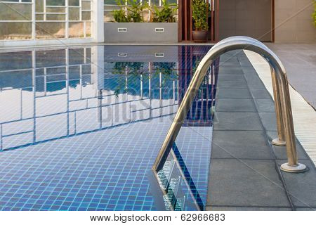 Reflection Of Water,swimming Pool With Steel Ladderbar.