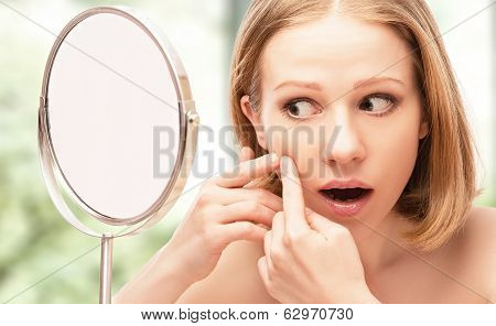 Beautiful Healthy Woman  Frightened Saw In The Mirror Acne And Wrinkles
