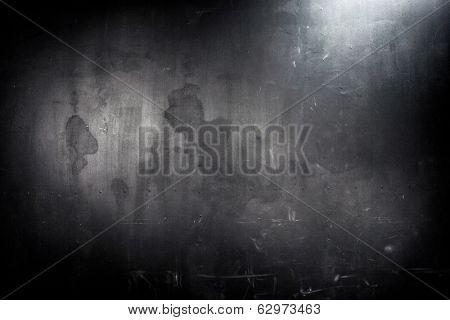 old grunge black wall, spot lighting