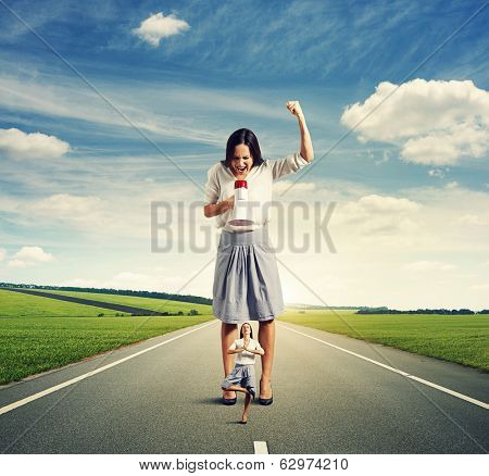 dissatisfied woman and calm yoga woman on the road