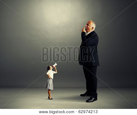 angry woman and big yawning boss over dark background