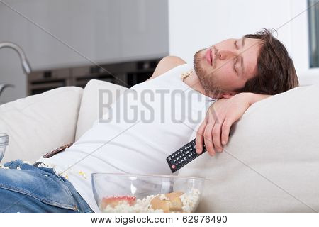 Tired Man Sleeping On Couch