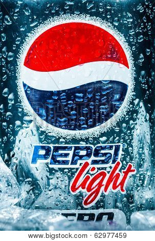 MOSCOW, RUSSIA-APRIL 4, 2014: Can of Pepsi cola Lignt on ice closeup. Pepsi is a carbonated soft drink that is produced and manufactured by PepsiCo. Created and developed in 1893.