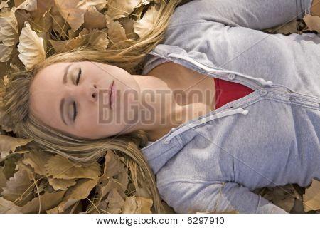 Woman In Leaves Eyes Closed