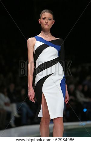ZAGREB, CROATIA - MARCH 28: Fashion model wearing clothes designed by Boris Banovic on the 'Fashion.hr' show on March 28, 2014 in Zagreb, Croatia.
