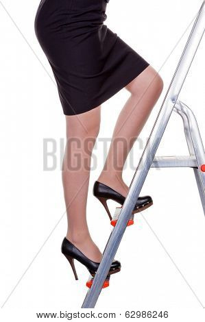 a woman in management climbing the career ladder. more women in leadership positions.