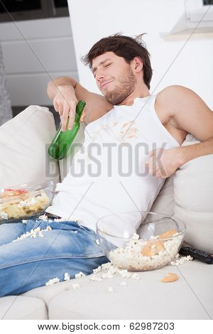 Lazy Man Sitting On Couch
