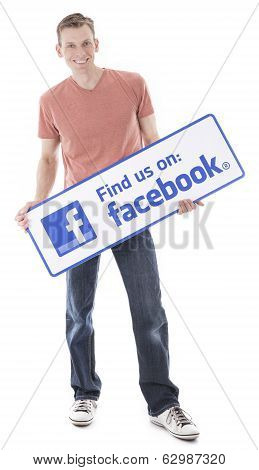 Man holding Facebook sign