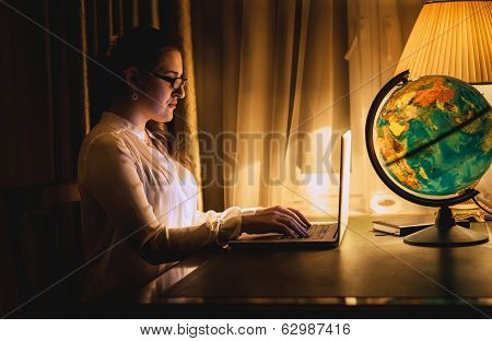 Sexy Woman Working On Laptop At Dark Room