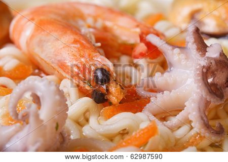 Mollusks And Shrimps And Chinese Noodles Soup Close Up