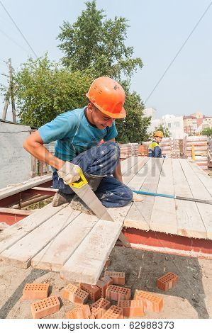 Builders working on residental house construction