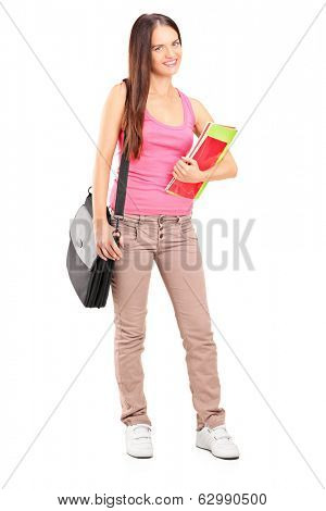 Full length portrait of a female student holding books isolated on white background