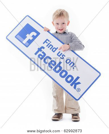 Child holding Facebook sign