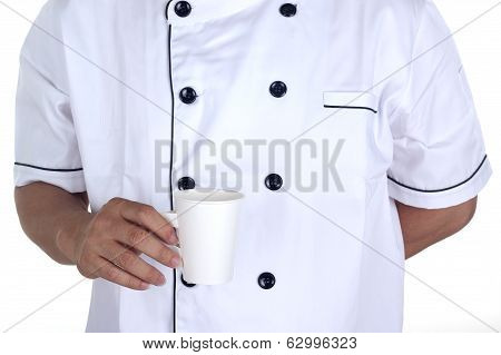 The Male Chef Holding A Papercup Of Coffee