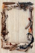 stock photo of driftwood  - Driftwood and seaweed abstract border over old oak background - JPG