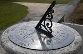 picture of sundial  - An old sundial showing the time of day - JPG