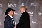 LAS VEGAS - APR 6:  George Strait, Jerry Jones at the 2014 Academy of Country Music Awards - Arrival