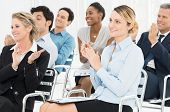 image of seminar  - Group Of Happy Multiracial Businesspeople Clapping At Seminar - JPG