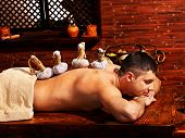 stock photo of panchakarma  - Man  having oil Ayurveda spa treatment - JPG