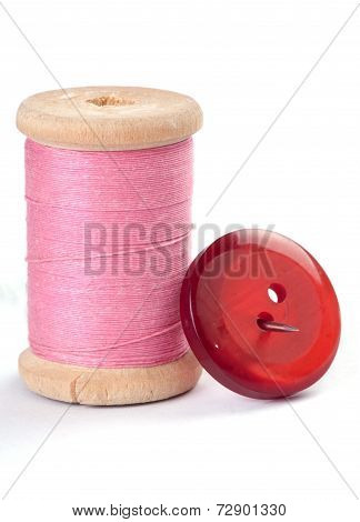 Thread And A Button With A Needle