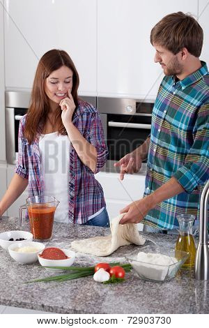 Couple During Making Pizza
