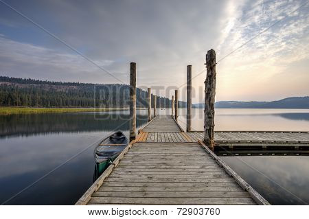 Dock at calm, tranquil lake.