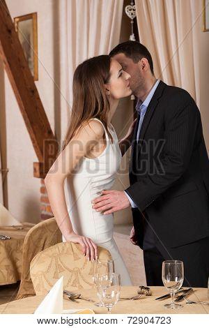 Man Kissing Young Woman Goodbye