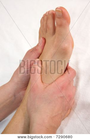 foot massage at the instep of the foot